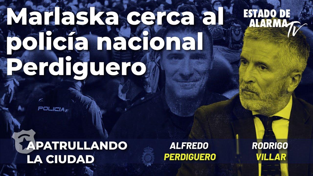 Marlaska cerca al Policía Nacional Alfredo Perdiguero; con Rodrigo Villar y Alfredo Perdiguero